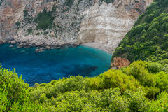 Blue water and rocks of small beach at Zakynthos island Stock Images