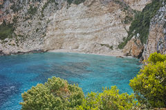 Blue water and rocks of small beach at Zakynthos island, Greece Royalty Free Stock Image