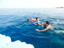Family swimming at sea. Blue water sea at Sharm El-Shaiekh Red sea Royalty Free Stock Photos