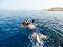 Family swimming at sea. Blue water sea at Sharm El-Shaiekh Red sea Royalty Free Stock Photography