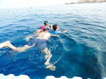 Family swimming at sea. Blue water sea at Sharm El-Shaiekh Red sea Royalty Free Stock Image