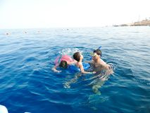 Family swimming at sea. Blue water sea at Sharm El-Shaiekh Red sea Stock Images
