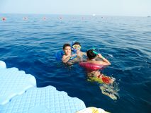 Family swimming at Red sea - Sharm El-Shaiekh. Blue water sea at Sharm El-Shaiekh Red sea Royalty Free Stock Photography