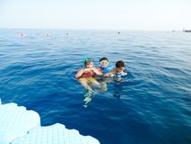 Family swimming at Red sea - Sharm El-Shaiekh. Blue water sea at Sharm El-Shaiekh Red sea Royalty Free Stock Image