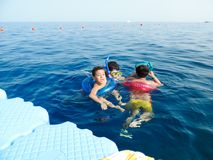 Family swimming at Red sea - Sharm El-Shaiekh. Blue water sea at Sharm El-Shaiekh Red sea Royalty Free Stock Photo