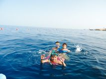 Family swimming at Red sea - Sharm El-Shaiekh. Blue water sea at Sharm El-Shaiekh Red sea Stock Image