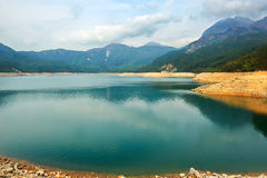 The blue water of Shek Pik lake Stock Photo
