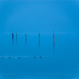 Blue water and sky stock images