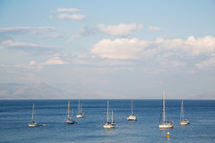 Blue water and sky background on the ocean with sailing boats. Stock Images
