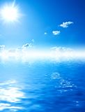Blue water and sky with sun Royalty Free Stock Image