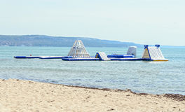Blue water slide on sea beach, kids game and jump area, close up. Outdoor Royalty Free Stock Photo