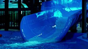 Blue water slides in summer amusement park. Attractions in the aqua park. Water slides and pool in the aqua park stock video footage
