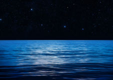 Blue Water Space. Blue ocean surface at night royalty free stock photos