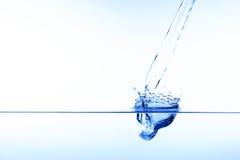 Blue water splash Stock Photography