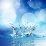 Blue water splash on bokeh background. Stock Photo