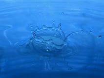 Blue water splash. Corona Royalty Free Stock Photography