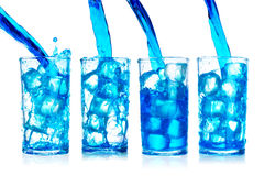 Blue water splash into glass isolated on white background Royalty Free Stock Photo