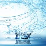 Blue water splash isolated on white background. Royalty Free Stock Photos