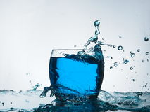 Blue water splash. Play with blue coloured water with flash Stock Photography