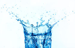 Blue water splashing isolated on white background. stock photography