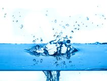 Blue water splashing  white background Royalty Free Stock Image