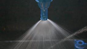Blue water sprayer, modern spay technology, Stock Photo