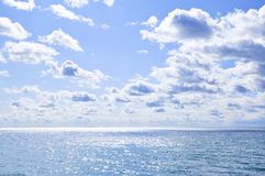 Blue water and sunny sky background Stock Photo