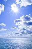 Blue water and sunny sky background Royalty Free Stock Image