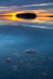 Blue Water Sunset. A beautiful sunset on the calm waters of Astotin Lake, Alberta, Canada royalty free stock photos