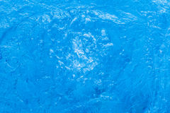 Blue water surface. Moving water surface in swimming pool Royalty Free Stock Photography