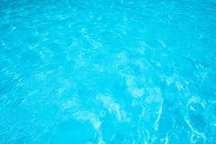 Blue water surface and texture in swimming pool. Closeup blue water surface and texture Royalty Free Stock Photography