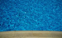 Water in the swimming pool. Blue water in the swimming pool Royalty Free Stock Photo