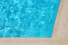 Blue water in swimming pool. Yellow stone and blue water in swimming pool Stock Images