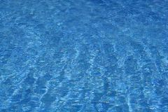 Blue water in swimming pool Royalty Free Stock Photos