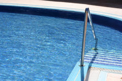 Blue water in swimming pool Royalty Free Stock Image