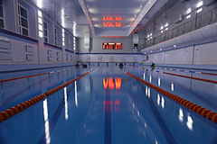 Blue water in swimming pool Stock Photos