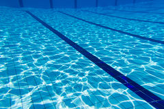 Blue water swimming pool underwater Stock Photos