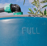 Blue water tank. Under an olive tree Royalty Free Stock Photography