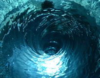 Blue water tornado. Water tornado with blue reflections, a twister with air in the middle of water royalty free stock photo