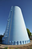 Blue water tower with latter Stock Image