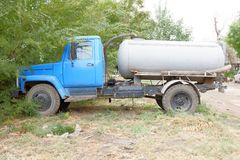 Blue water truck standing outdoors Stock Photo