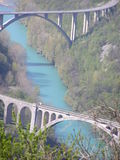 Blue water under the bridges. Blue water of the Soca River under two bridges near Solkan, Slovenia Stock Photography