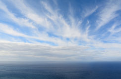 Blue water under a cloudy sky Royalty Free Stock Photo