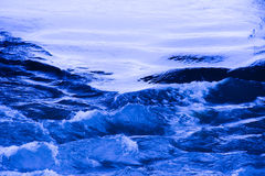 Blue water wave in a stream Stock Images