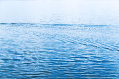 Blue water and waves after boat going Royalty Free Stock Photo