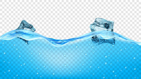 Blue water waves with ice cubes. Ice cubes in transparent blue waves of water with air bubbles Royalty Free Stock Photo