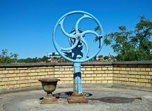 Blue water well pump, with wheel, on summer sun Stock Images