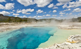 Blue water at Yellowstone National park. Yellowstone National Park - geothermal blue lake Royalty Free Stock Photography