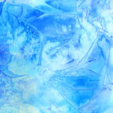 Blue watercolor background with blotchiness and paint strokes. Winter frost texture Royalty Free Stock Photography