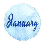 Blue watercolor circle with word January isolated on a white background. Stock Photos